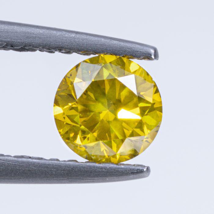 Brilliant 0,54 Karat, rund, Expertise IGI, Farbe : lebhaftes gelb